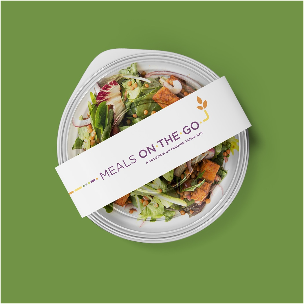 Photo of pre-packaged meal with Feeding Tampa Bay's Meals on the Go branding