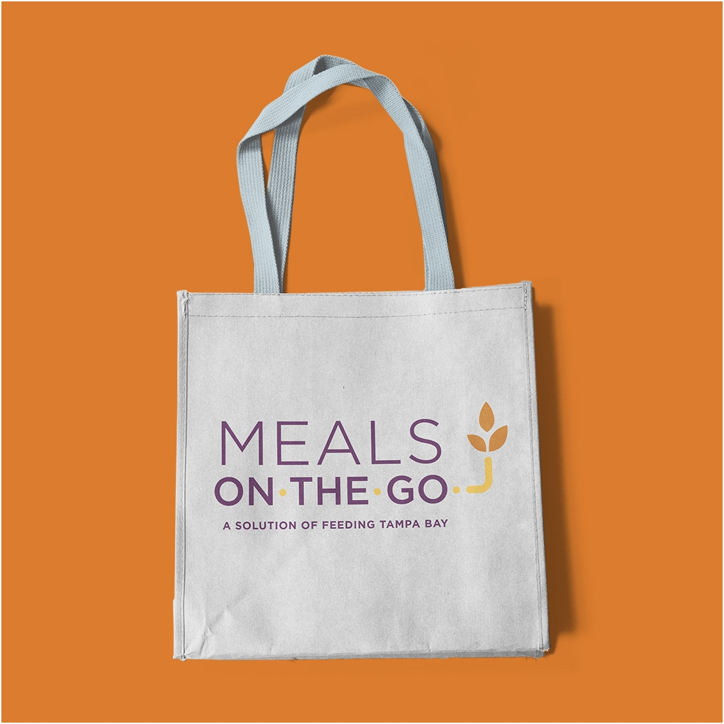 Image of a tote bag with Feeding Tampa Bay's Meals on the Go branding