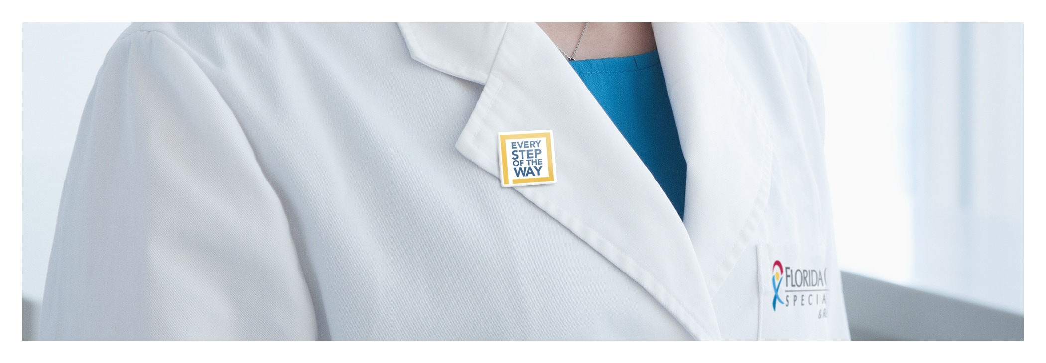 Photo of a physician wearing an Every Step of the Way lapel pin