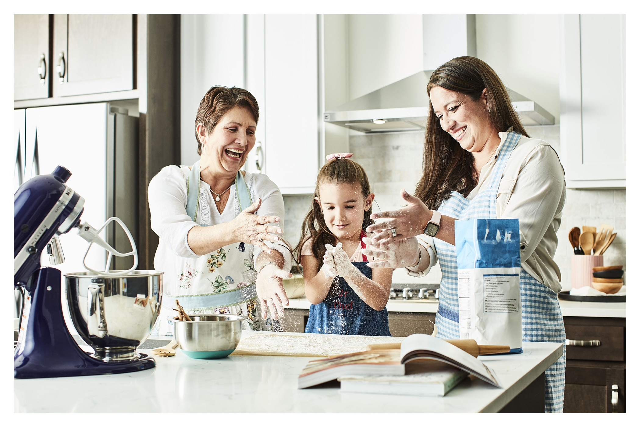 Feel the Love - Photo of a grandmother baking in the kitchen with her daughter and granddaughter
