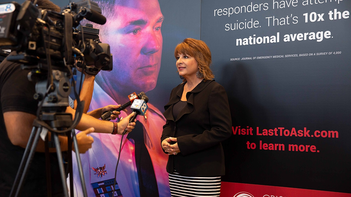 Photo of Colleen Chappell being interviewed by the media during an event for the Crisis Center of Tampa Bay supporting First Responders