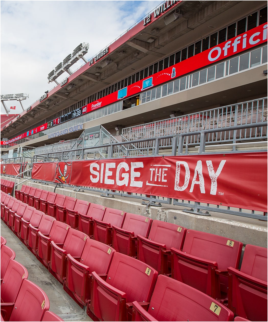 Photo of Siege the Day banner behind seats in stadium