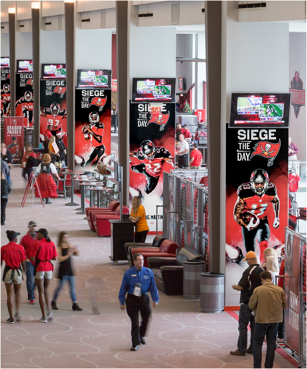 Photo of Siege the Day posters along concourse columns in club level of Raymond James Stadium