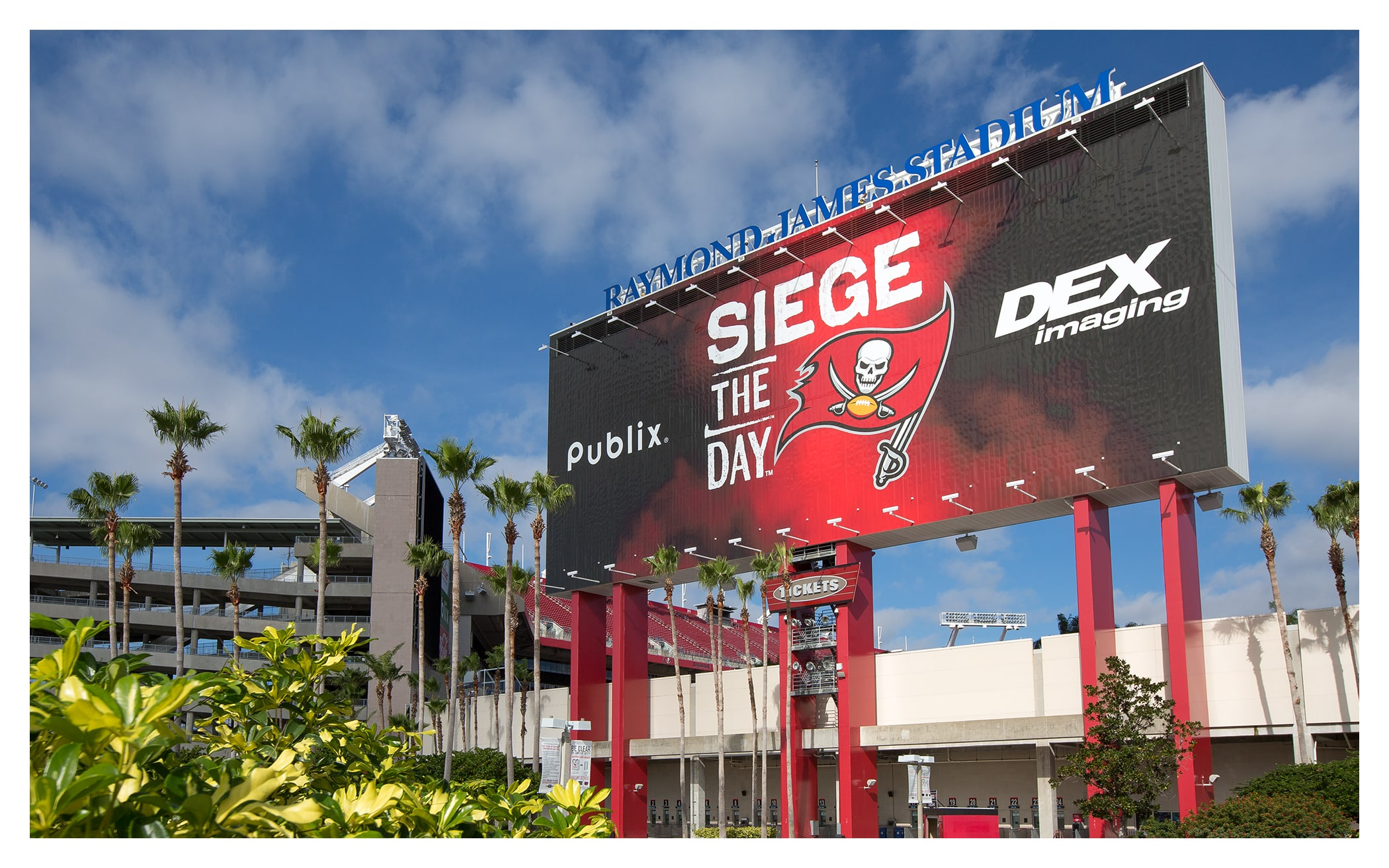 Photo of Siege the Day mural on the back of the scoreboards at Raymond James Stadium