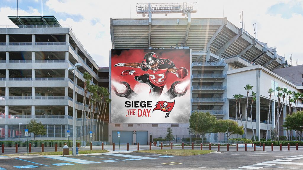 Large building graphic featuring Siege the Day at Raymond James Stadium